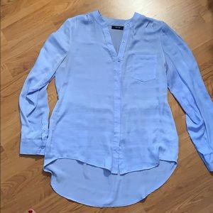 Sky blue blouse.